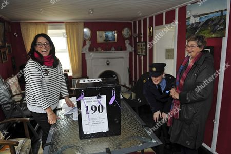 Magella Harkin (l) and Garda Margaret Byrne (c) Member of the Irish National Police Force Share a Joke with Maureen Osullivan (r) As She Cast Her Vote on the Island of Inishfree where Two People Cast Their Votes Off the Coast of Donegal in Ireland 25 February 2016 Over Two Thousand People Live on Islands Off the Coast of Ireland who Vote Early in the Irish General Election the Rest of the Country Go to the Polls on 26 February 2016 Ireland Inishfree