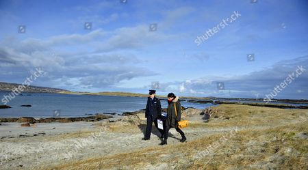 Garda Margaret Byrne (l) Member of the Irish National Police Force Carries a Ballot Box with Magella Harkin From a Boat to the Polling Station on the Island of Inishfree where Two People Voted Off the Coast of Donegal in Ireland 25 February 2016 Over Two Thousand People Live on Islands Off the Coast of Ireland who Vote Early in the Irish General Election the Rest of the Country Go to the Polls on 26 February 2016 Ireland Inishfree