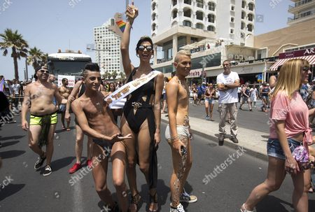 Stock Photo of Israeli-arab Talleen Abu Hanna (c) 21 a Palestinian Christian From Northern Israel and Recently Crowned Miss Trans Israel 2016 in the Street on the Mediterranean Sea Waterfront where She was Dancing and Posing For Photographs with Members of the Lgbt Community During the Gay Pride Parade in Tel Aviv Israel 03 June 2016 the Parade Attracted Well Over 100 000 Members of the Lgbt (lesbian Gay Bisexual and Transgender) Community and Supporters Israel Tel Aviv