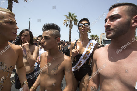 Stock Image of Israeli-arab Talleen Abu Hanna (2-r) 21 a Palestinian Christian From Northern Israel and Recently Crowned Miss Trans Israel 2016 in the Street on the Mediterranean Sea Waterfront where She was Dancing and Posing For Photographs with Members of the Lgbt Community During the Gay Pride Parade in Tel Aviv Israel 03 June 2016 the Parade Attracted Well Over 100 000 Members of the Lgbt (lesbian Gay Bisexual and Transgender) Community and Supporters Israel Tel Aviv