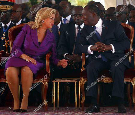 Ivory Coast President Alassane Ouattara (r) Speaks with His Wife Dominique Folloroux-ouattara (l) During Celebrations Marking the 55th Anniversary of Independence Infront of the Presidential Palace in Abidjan Ivory Coast 07 August 2015 on 07 August 1960 Ivory Coast Became an Independent Nation From Its Former Colonial Master France with Felix Houphouet-boigny As Its First President Presidential Elections Are Scheduled to Take Place in October 2015 Cote D'ivoire Abidjan