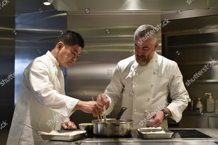 Stock Image of Brazilian Chef Alex Atala (r) and Japanese Chef Yoshihiro Narisawa Prepare Dishes in Narisawas Restaurant Kitchen in Tokyo Japan 08 February 2016 Both Chefs Will Cook Together For a Dinner Marking the 120th Anniversary of the Establishment of Diplomatic Relations Between the Two Countries Japan Tokyo
