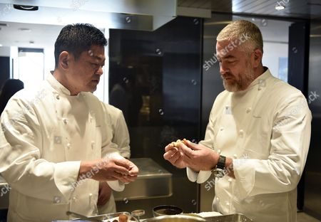 Stock Photo of Brazilian Chef Alex Atala (r) and Japanese Chef Yoshihiro Narisawa Prepare Dishes in Narisawas Restaurant Kitchen in Tokyo Japan 08 February 2016 Both Chefs Will Cook Together For a Dinner Marking the 120th Anniversary of the Establishment of Diplomatic Relations Between the Two Countries Japan Tokyo