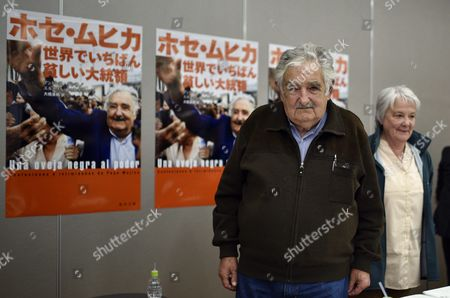Former Uruguayan President Jose 'Pepe' Mujica (2-r) and His Wife Lucia Topolansky (r) Stand Next to a Poster Promoting the Japanese Translation of the Book 'Una Oveja Negra Al Poder: Confesiones E Intimidades De Pepe Mujica' (lit a Black Sheep to Power: Confessions and Intimacies of Pepe Mujica) in Tokyo Japan 06 April 2016 Jose Mujica is in Japan to Promote the Publication of the Book a Biographical Account of His Life and to Participate in Panel Discussions with Students Japan Tokyo