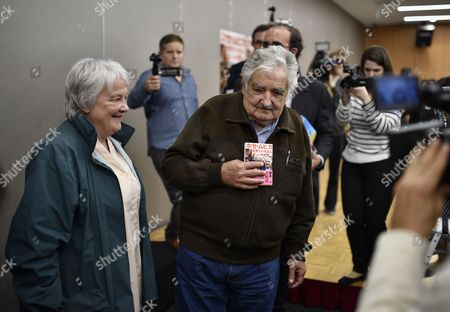 Former Uruguayan President Jose 'Pepe' Mujica (c) and His Wife Lucia Topolansky (l) Are Surrounded by Media After Attending a Press Conference For the Japanese Translation of the Book 'Una Oveja Negra Al Poder: Confesiones E Intimidades De Pepe Mujica' (lit a Black Sheep to Power: Confessions and Intimacies of Pepe Mujica) in Tokyo Japan 06 April 2016 Jose Mujica is in Japan to Promote the Publication of the Book a Biographical Account of His Life and to Participate in Panel Discussions with Students Japan Tokyo