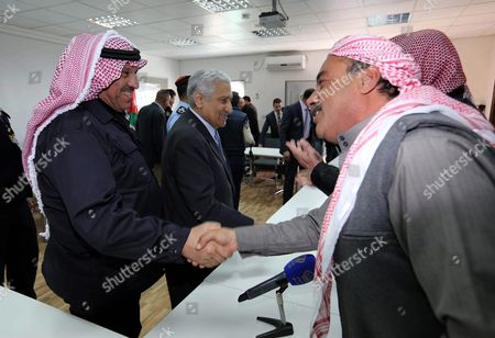 Jordanian Prime Minister Abdullah Ensour (c) and Jordanian Interior Minister Salameh Hamad (l) Shake Hands with Syrian Refugees at Azraq Syrian Refugee Camp Jordan 30 January 2016 Jordanian Prime Minister Abdullah Ensour Visited the Camp Days Before the Fourth International Donors' Conference in London to Discuss the Refugee Crisis and Ways to Support Them and the Host Countries Jordan Azraq
