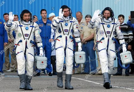 Crew Members of the Mission to the International Space Station (iss) (l-r) Kazakhstan's Cosmonaut Aydyn Aimbetov Russian Cosmonaut Sergei Volkov and Denmark's Astronaut Andreas Mogensen From the European Space Agency (esa) Walk Before Their Launch to the Iss in Baikonur Kazakhstan Early 02 September 2015 the Launch of the Soyuz Spacecraft Will Send Russian Cosmonaut Sergei Volkov on a Six-month Mission Aboard the International Space Station (iss) and Kazakhstan's Cosmonaut Aydyn Aimbetov and Denmark's Astronaut Andreas Mogensen From Esa Will Return to Earth After Ten Days Kazakhstan Baikonur
