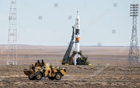Russian Policemen on a Russian Apc Brdm-2 Guard in Front of Rocket Carrying the Soyuz Tma-18m Spacecraft with the Crew Members For the International Space Station (iss) About to Lift Off From the Cosmodrome in Baikonur Kazakhstan 02 September 2015 the Launch of the Soyuz Spacecraft Sends Russian Cosmonaut Sergei Volkov on a Six-month Mission Aboard the International Space Station (iss) and Kazakhstan's Cosmonaut Aydyn Aimbetov and Denmark's Astronaut Andreas Mogensen From the European Space Agency Will Return to the Earth After Ten Days Kazakhstan Baikonur