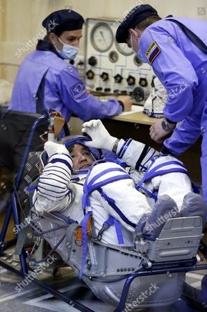 Russian Roscosmos Specialists Help the Crew Member of the Mission to the International Space Station Iss Kazakhstan's Cosmonaut Aydyn Aimbetov with His Space Suit Before Boarding the Soyuz Tma-18m Rocket Just a Few Hours Before His Launch to the International Space Station Iss in Baikonur Kazakhstan Early 02 September 2015 the Launch of the Soyuz Spacecraft Will Send Russian Cosmonaut Sergei Volkov on a Six-month Mission Aboard the International Space Station (iss) and Kazakhstan's Cosmonaut Aydyn Aimbetov and Denmark's Astronaut Andreas Mogensen From Esa Will Return to Earth After Ten Days Kazakhstan Baikonur