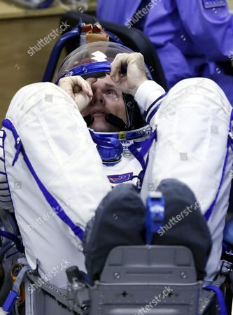 Crew Member of the Mission to the International Space Station Iss Denmark's Astronaut Andreas Mogensen (c) From the European Space Agency Has His Space Suit Checked Before Boarding the Soyuz Tma-18m Rocket Just a Few Hours Before His Launch to the International Space Station Iss in Baikonur Kazakhstan Early 02 September 2015 the Launch of the Soyuz Spacecraft Will Send Russian Cosmonaut Sergei Volkov on a Six-month Mission Aboard the International Space Station (iss) and Kazakhstan's Cosmonaut Aydyn Aimbetov and Denmark's Astronaut Andreas Mogensen From Esa Will Return to Earth After Ten Days Kazakhstan Baikonur