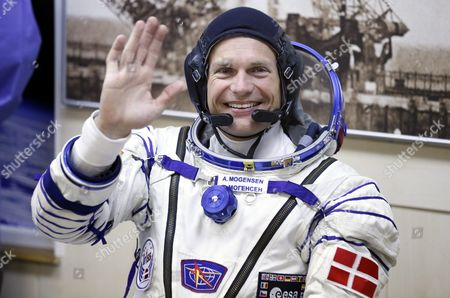 Crew Member of the Mission to the International Space Station Iss Denmark's Astronaut Andreas Mogensen (c) From the European Space Agency Waves After His Space Suit was Checked Before Boarding the Soyuz Tma-18m Rocket Just a Few Hours Before His Launch to the International Space Station Iss in Baikonur Kazakhstan Early 02 September 2015 the Launch of the Soyuz Spacecraft Will Send Russian Cosmonaut Sergei Volkov on a Six-month Mission Aboard the International Space Station (iss) and Kazakhstan's Cosmonaut Aydyn Aimbetov and Denmark's Astronaut Andreas Mogensen From Esa Will Return to Earth After Ten Days Kazakhstan Baikonur