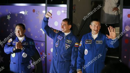 Crew Members of the Mission to the International Space Station (iss) (l-r) Kazakhstan's Cosmonaut Aydyn Aimbetov Russian Cosmonaut Sergei Volkov and Denmark's Astronaut Andreas Mogensen (r) From the European Space Agency Wave As They Depart the Cosmonaut Hotel to Head to Another Building Across the Baikonur Cosmodrome where They Will Suit-up For Their Soyuz Launch in Baikonur Kazakhstan Early 02 September 2015 the Launch of the Soyuz Spacecraft Will Send Russian Cosmonaut Sergei Volkov on a Six-month Mission Aboard the International Space Station (iss) and Kazakhstan's Cosmonaut Aydyn Aimbetov and Denmark's Astronaut Andreas Mogensen From Esa Will Return to Earth After Ten Days Kazakhstan Baikonur