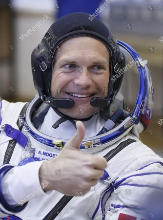 Crew Member of the Mission to the International Space Station Iss Denmark's Astronaut Andreas Mogensen (c) From the European Space Agency Gives a Thumb Up After His Space Suit was Checked Before Boarding the Soyuz Tma-18m Rocket Just a Few Hours Before His Launch to the International Space Station Iss in Baikonur Kazakhstan Early 02 September 2015 the Launch of the Soyuz Spacecraft Will Send Russian Cosmonaut Sergei Volkov on a Six-month Mission Aboard the International Space Station (iss) and Kazakhstan's Cosmonaut Aydyn Aimbetov and Denmark's Astronaut Andreas Mogensen From Esa Will Return to Earth After Ten Days Kazakhstan Baikonur