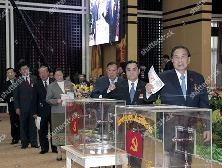 A Photo Made Available on 22 January 2016 Shows Laos President Choummaly Sayasone (r) and Prime Minister Thongsing Thammavong (2-r) Cast Their Ballots During the Communist Party Congress in Vientiane Laos 21 January 2016 the Laos' Secretive Ruling Communist Party Held Its Five-day Congress to Choose a New Party Leader and Select Politburo and Central Committee Lao People's Democratic Republic Vientiane