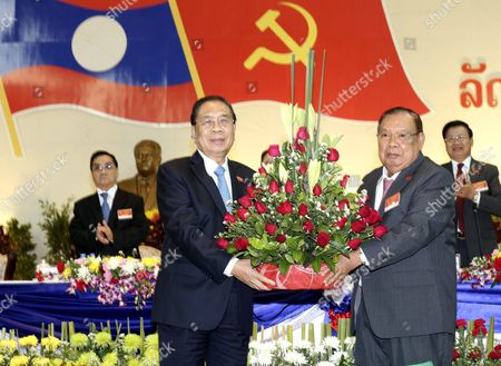 Outgoing Party General Secretary and Laos President Choummaly Sayasone (l) Gives Flower to Greet Vice President and Newly Chose Communist Party Leader Bounnhang Vorachit (r) During the Communist Party Congress in Vientiane Laos 22 January 2016 the Lao People's Revolutionary Party Choose Vice President Bounnhang Vorachit to Be a New Leader of Its Ruling Party Lao People's Democratic Republic Vientiane