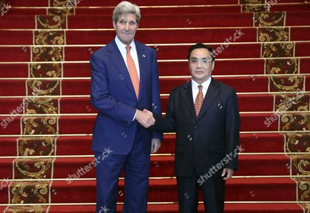 Us Secretary of State John Kerry (l) Shakes Hands with Laos Prime Minister Thongsing Thammavong (r) During Their Meeting at the Government House in Vientiane Laos 25 January 2016 Kerry is the Third Us Secretary of State in Six Decades to Visit Laos Aimed to Strengthening the Two Countries Bilateral Relations Lao People's Democratic Republic Vientiane