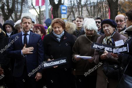 Latvian Prime Minister Laimdota Straujuma (2-l) and French Ambassador to Latvia Stephane Visconti (l) Pay Their Respect in Front of the French Embassy in Riga Latvia 14 November 2015 in Tribute to Victims in the 13 November Paris Terrorist Attacks at Least 120 People Have Been Killed in a Series of Attacks in Paris France on Late 13 November 2015 According to French Officials Eight Assailants Were Killed Seven when They Detonated Their Explosive Belts and One when He was Shot by Officers Police Said Latvia Riga