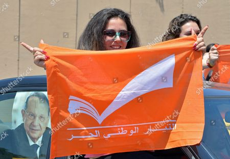 Supporters of the 'Free Patriotic Movement' Party of Presidential Candidate General Michel Aoun Show His Portrait and Party Flags During a Protest of what They Claim is 'Political Exclusion of Christians' in Front of the Lebanese Government Palace in Downtown Beirut Lebanon 09 July 2015 Lebanon Marked Its Longest Ever Period Without a Serving Head of State - More Than 400 Days - Since President Michel Suleiman Ended His Mandate Ushering a Protracted Period of Political Bickering Over His Replacement Opposing Parties Blame Each Other For the Deadlock According to Unwritten Rules Governing Lebanon's Politics the President is Always a Maronite Christian the Prime Minister a Sunni Muslim and the Speaker of Parliament a Shiite Muslim Lebanon Beirut