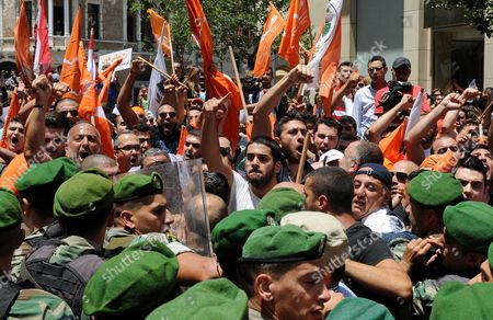 Lebanese Army Soldiers Block a Group of Supporters of the 'Free Patriotic Movement' Party of Presidential Candidate General Michel Aoun During a Protest of what They Claim is 'Political Exclusion of Christians' in Front of the Lebanese Government Palace in Downtown Beirut Lebanon 09 July 2015 Lebanon Marked Its Longest Ever Period Without a Serving Head of State - More Than 400 Days - Since President Michel Suleiman Ended His Mandate Ushering a Protracted Period of Political Bickering Over His Replacement Opposing Parties Blame Each Other For the Deadlock According to Unwritten Rules Governing Lebanon's Politics the President is Always a Maronite Christian the Prime Minister a Sunni Muslim and the Speaker of Parliament a Shiite Muslim Lebanon Beirut