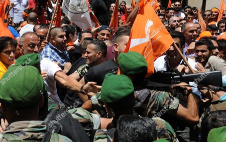 Lebanese Army Soldiers Scuffle with a Group of Supporters of the 'Free Patriotic Movement' Party of Presidential Candidate General Michel Aoun During a Protest of what They Claim is 'Political Exclusion of Christians' in Front of the Lebanese Government Palace in Downtown Beirut Lebanon 09 July 2015 Lebanon Marked Its Longest Ever Period Without a Serving Head of State - More Than 400 Days - Since President Michel Suleiman Ended His Mandate Ushering a Protracted Period of Political Bickering Over His Replacement Opposing Parties Blame Each Other For the Deadlock According to Unwritten Rules Governing Lebanon's Politics the President is Always a Maronite Christian the Prime Minister a Sunni Muslim and the Speaker of Parliament a Shiite Muslim Lebanon Beirut