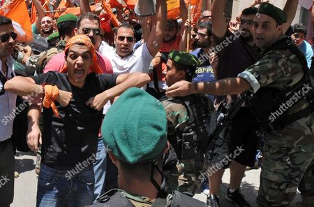 A Supporter of the 'Free Patriotic Movement' Party of Presidential Candidate General Michel Aoun Argues with Lebanese Army Soldiers Blocking a Road During a Protest of what They Claim is 'Political Exclusion of Christians' in Front of the Lebanese Government Palace in Downtown Beirut Lebanon 09 July 2015 Lebanon Marked Its Longest Ever Period Without a Serving Head of State - More Than 400 Days - Since President Michel Suleiman Ended His Mandate Ushering a Protracted Period of Political Bickering Over His Replacement Opposing Parties Blame Each Other For the Deadlock According to Unwritten Rules Governing Lebanon's Politics the President is Always a Maronite Christian the Prime Minister a Sunni Muslim and the Speaker of Parliament a Shiite Muslim Lebanon Beirut