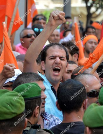 A Supporter of the 'Free Patriotic Movement' Party of Presidential Candidate General Michel Aoun Shouts at Lebanese Army Soldiers Blocking a Road During a Protest of what They Claim is 'Political Exclusion of Christians' in Front of the Lebanese Government Palace in Downtown Beirut Lebanon 09 July 2015 Lebanon Marked Its Longest Ever Period Without a Serving Head of State - More Than 400 Days - Since President Michel Suleiman Ended His Mandate Ushering a Protracted Period of Political Bickering Over His Replacement Opposing Parties Blame Each Other For the Deadlock According to Unwritten Rules Governing Lebanon's Politics the President is Always a Maronite Christian the Prime Minister a Sunni Muslim and the Speaker of Parliament a Shiite Muslim Lebanon Beirut