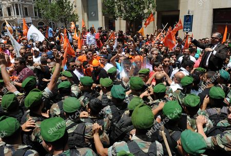 Supporters of the 'Free Patriotic Movement' Party of Presidential Candidate General Michel Aoun Scuffle with Lebanese Army Soldiers Blocking a Road During a Protest of what They Claim is 'Political Exclusion of Christians' in Front of the Lebanese Government Palace in Downtown Beirut Lebanon 09 July 2015 Lebanon Marked Its Longest Ever Period Without a Serving Head of State - More Than 400 Days - Since President Michel Suleiman Ended His Mandate Ushering a Protracted Period of Political Bickering Over His Replacement Opposing Parties Blame Each Other For the Deadlock According to Unwritten Rules Governing Lebanon's Politics the President is Always a Maronite Christian the Prime Minister a Sunni Muslim and the Speaker of Parliament a Shiite Muslim Lebanon Beirut