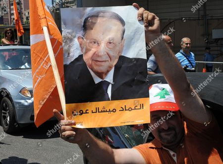 Supporters of the 'Free Patriotic Movement' Party of Presidential Candidate General Michel Aoun Carry His Portrait and Party Flags During a Protest of what They Claim is 'Political Exclusion of Christians' in Front of the Lebanese Government Palace in Downtown Beirut Lebanon 09 July 2015 Lebanon Marked Its Longest Ever Period Without a Serving Head of State - More Than 400 Days - Since President Michel Suleiman Ended His Mandate Ushering a Protracted Period of Political Bickering Over His Replacement Opposing Parties Blame Each Other For the Deadlock According to Unwritten Rules Governing Lebanon's Politics the President is Always a Maronite Christian the Prime Minister a Sunni Muslim and the Speaker of Parliament a Shiite Muslim Lebanon Beirut