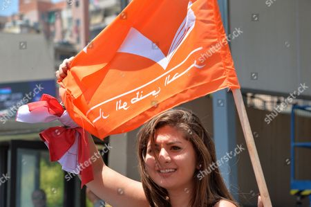 Supporters of the 'Free Patriotic Movement' Party of Presidential Candidate General Michel Aoun Carry Party Flags During a Protest of what They Claim is 'Political Exclusion of Christians' in Front of the Lebanese Government Palace in Downtown Beirut Lebanon 09 July 2015 Lebanon Marked Its Longest Ever Period Without a Serving Head of State - More Than 400 Days - Since President Michel Suleiman Ended His Mandate Ushering a Protracted Period of Political Bickering Over His Replacement Opposing Parties Blame Each Other For the Deadlock According to Unwritten Rules Governing Lebanon's Politics the President is Always a Maronite Christian the Prime Minister a Sunni Muslim and the Speaker of Parliament a Shiite Muslim Lebanon Beirut