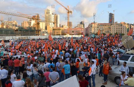 Stock Photo of Supporters of the 'Free Patriotic Movement' Party of Presidential Candidate General Michel Aoun Carry Party Flags During a Protest Claiming Violations of Constitution at Martyrs Square in Beirut Lebanon 12 August 2015 Lebanese Politicians Have Been Unable to Agree on a Replacement For Former President Michel Suleiman For Over Four Hundred Days Since His Mandated Ended Swapping Blame Over the Prolonged Deadlock Lebanon Beirut