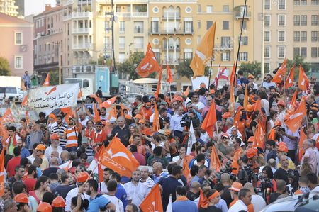 Supporters of the 'Free Patriotic Movement' Party of Presidential Candidate General Michel Aoun Carry Party Flags During a Protest Claiming Violations of Constitution at Martyrs Square in Beirut Lebanon 12 August 2015 Lebanese Politicians Have Been Unable to Agree on a Replacement For Former President Michel Suleiman For Over Four Hundred Days Since His Mandated Ended Swapping Blame Over the Prolonged Deadlock Lebanon Beirut