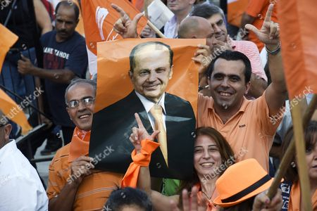 Supporters of Lebanon's Presidential Candidate General Michel Aoun's Free Patriotic Movement Party Carry Party Flags and a Picture of Aoun During a Protest Demanding Reform and the Right to National Partnership in Martyrs Square Beirut Lebanon 04 September 2015 For Over Four Hundred Days Lebanon Has Been Without a President Since the Mandate of Michel Suleiman Lapsed Leading to Political Gridlock As Factions Failed to Choose a Suitable Replacement Leading to Crises Such As the Recent Garbage Issue Which Resulted in Widespread Protests Calling For Political Reform Lebanon Beirut