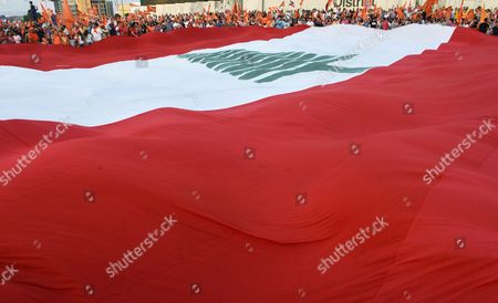 Supporters of Lebanon's Presidential Candidate General Michel Aoun's Free Patriotic Movement Party Hold a Huge National Flag During a Protest Demanding Reform and the Right to National Partnership in Martyrs Square Beirut Lebanon 04 September 2015 For Over Four Hundred Days Lebanon Has Been Without a President Since the Mandate of Michel Suleiman Lapsed Leading to Political Gridlock As Factions Failed to Choose a Suitable Replacement Leading to Crises Such As the Recent Garbage Issue Which Resulted in Widespread Protests Calling For Political Reform Lebanon Beirut