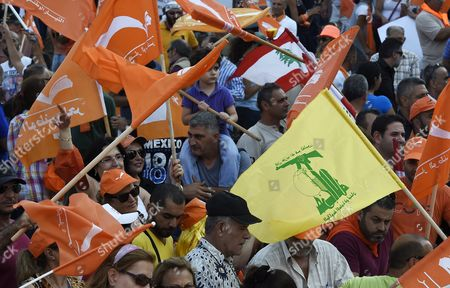 Supporters of Lebanon's Presidential Candidate General Michel Aoun's Free Patriotic Movement Party Carry Party and Hezbollah Flags During a Protest Demanding Reform and the Right to National Partnership in Martyrs Square Beirut Lebanon 04 September 2015 For Over Four Hundred Days Lebanon Has Been Without a President Since the Mandate of Michel Suleiman Lapsed Leading to Political Gridlock As Factions Failed to Choose a Suitable Replacement Leading to Crises Such As the Recent Garbage Issue Which Resulted in Widespread Protests Calling For Political Reform Lebanon Beirut