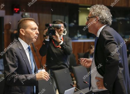 Governor of the Central Bank of Greece Yannis Stournaras (l) Talks with Luxembourg's Finance Minister Pierre Gramegna (r) at the Start of the Third Session of a European Finance Ministers Meeting at the European Convention Center in Luxembourg 12 September 2015 Luxembourg Luxembourg