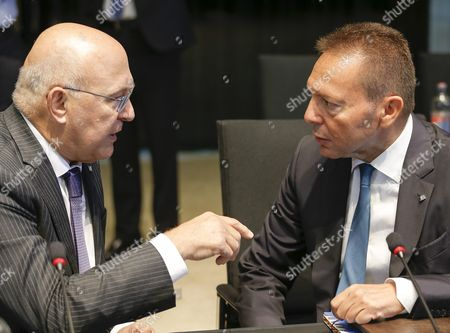 French Finance Minister Michel Sapin (l) Talks with Governor of the Central Bank of Greece Yannis Stournaras (r) at the Start of the Third Session of a European Finance Ministers Meeting at the European Convention Center in Luxembourg 12 September 2015 Luxembourg Luxembourg