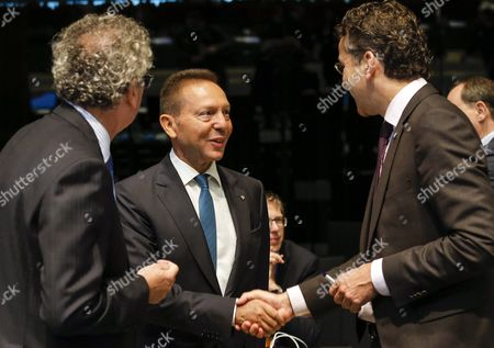 (l-r) Luxembourg's Finance Minister Pierre Gramegna Governor of the Central Bank of Greece Yannis Stournaras and President of Eurogroup and Dutch Finance Minister Jeroen Dijsselbloem Talk at the Start of the Third Session of a European Finance Ministers Meeting at the European Convention Center in Luxembourg 12 September 2015 Luxembourg Luxembourg