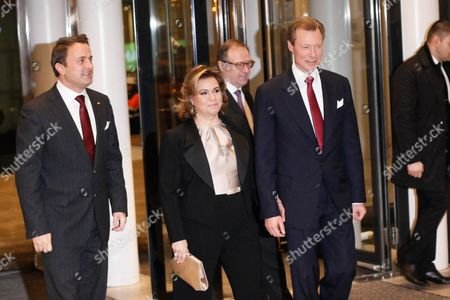 Luxembourg's Prime Minister Xavier Bettel (l) Grand Duke Henri (r) and Grand Duchess Maria-teresa (c) Arrive at the Philharmonie Luxembourg the Grande-duchesse Josephine-charlotte Concert Hall in Luxembourg 09 January 2016 the Royal Family Invited to a Special Concert by the Luxembourg Philharmonic Orchestra to Mark the 95th Birthday of Former Grand Duke Jean on 05 January Luxembourg Luxembourg