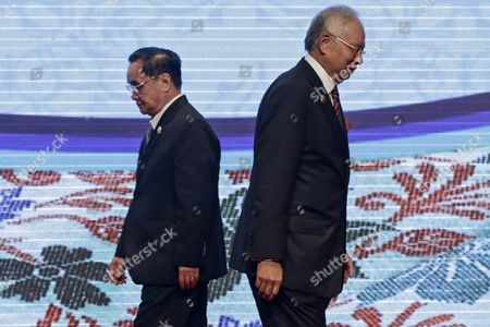 Malaysia Prime Minister Najib Razak (r) Pass by Laos Prime Minister Thongsing Thammavong After Handing Over the Asean Gavel During the Closing Ceremony of 27th Asean Summit in Kuala Lumpur Malaysia 22 November 2015 Malaysia is Hosting the 27th Asean Summit a Meeting Between Asean Member Countries and Its Three Dialogue Partners China Japan and Korea As Well As a Meeting of the East Asia Summit (eas) Forum Malaysia Kuala Lumpur