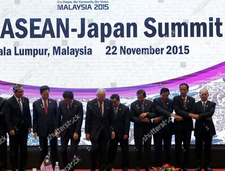 (l-r) Thailand Prime Minister Prayut Chan-o-cha Vietnam Prime Minister Nguyen Tan Dung Japan Prime Minister Shinzo Abe Malaysia Prime Minister Najib Razak Laos Prime Minister Thongsing Thammavong Brunei Sultan Hassanal Bolkiah Cambodia Prime Minister Hun Sen Indonesia President Joko Widodo Myanmar President Thein Sein Leave the Stage After a Group Photo During the 18th Asean-japan Summit As Part of the 27th Asean Summit in Kuala Lumpur Malaysia 22 November 2015 Malaysia is Hosting the 27th Asean Summit a Meeting Between Asean Member Countries and Its Three Dialogue Partners China Japan and Korea As Well As a Meeting of the East Asia Summit (eas) Forum Malaysia Kuala Lumpur