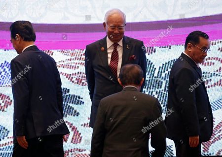 Malaysian Prime Minister Najib Razak (back C) Vietnames Prime Minister Nguyen Tan Dung (l) Laos Prime Minister Thongsing Thammavong (r) and Brunei Sultan Hassanal Bolkiah (front) Look For Their Positions on Stage For a Group Photo Session During the 7th Asean-united Nations Summit As Part of the 27th Asean Summit in Kuala Lumpur Malaysia 22 November 2015 Malaysia is Hosting the 27th Asean Summit a Meeting Between Asean Member Countries and Its Three Dialogue Partners China Japan and Korea As Well As a Meeting of the East Asia Summit (eas) Forum Malaysia Kuala Lumpur