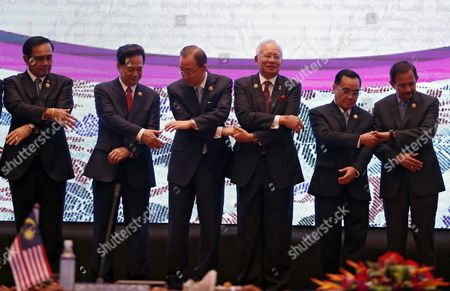Stock Image of (l-r) Thailand Prime Minister Prayut Chan-o-cha Vietnam Prime Minister Nguyen Tan Dung United Nations Secretary General Ban Ki-moon Malaysia Prime Minister Najib Razak Laos Prime Minister Thongsing Thammavong Brunei Sultan Hassanal Bolkiah Reach Their Hands For a Group Photo During the 7th Asean-united Nations Summit As Part of the 27th Asean Summit in Kuala Lumpur Malaysia 22 November 2015 Malaysia is Hosting the 27th Asean Summit a Meeting Between Asean Member Countries and Its Three Dialogue Partners China Japan and Korea As Well As a Meeting of the East Asia Summit (eas) Forum Malaysia Kuala Lumpur