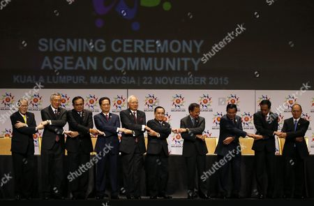 Asean Member Country Leaders (l-r) Philippines President Benigno Aquino Iii Singapore Prime Minister Lee Hsien Loong Thailand Prime Minister Prayut Chan-o-cha Vietnam Prime Minister Nguyen Tan Dung Malaysia Prime Minister Najib Razak Laos Prime Minister Thongsing Thammavong Brunei Sultan Hassanal Bolkiah Cambodia Prime Minister Hun Sen Indonesia President Joko Widodo Myanmar President Thein Sein Join Hands For a Group Photo During the Signing Ceremony As Part of the 27th Asean Summit in Kuala Lumpur Malaysia 22 November 2015 Malaysia is Hosting the 27th Asean Summit a Meeting Between Asean Member Countries and Its Three Dialogue Partners China Japan and Korea As Well As a Meeting of the East Asia Summit (eas) Forum Malaysia Kuala Lumpur