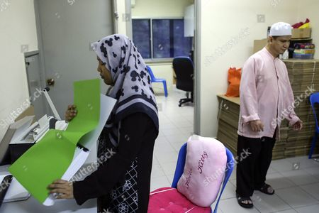 Siti Najiha Abd Rahman (l) 24 Print the Koran in Braille Writing System As Muhamad Lee (r) 49 Pass by at the Malaysia Muslim Association of Visually Impaired People Center (pertim) During Ramadan in Kuala Lumpur Malaysia 24 June 2016 Pertim was Established on 1996 is the Only Ngo That Obtained a Permission From the Malaysia Goverment For Copyright and Printing of Koran in Braille Koran in Braille Must Be Read From Left to Right Through the Six Volumes That Span the Entire Paragraph Koran Generally Koran Has 114 Chapters and 6 666 Verses and According to the Belief of Islam Muslims Around the World Celebrate the Holy Month of Ramadan by Praying During the Night Time and Abstaining From Eating and Drinking During the Period Between Sunrise and Sunset Ramadan is the Ninth Month in the Islamic Calendar and It is Believed That the Korans First Verse was Revealed During Its Last 10 Nights Malaysia Kuala Lumpur