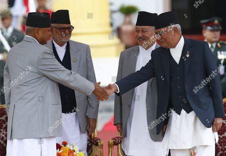 Nepal's President Ram Baran Yadav (l) Congratulates Newly Elected Prime Minister Khadga Prasad Sharma Oli (r) After the Oath of Ceremony at the Presidential Office in Kathmandu Nepal 12 October 2015 Khadga Prasad Sharma Oli Became the 38th Prime Minister of Nepal Winning a Parliamentary Vote by a Majority Nepal Kathmandu