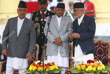 Nepal's Newly Elected Prime Minister Kp Sharma Oli (r) and President Ram Baran Yadav (c) Talks While Vice President Parmananda Jha (l) Looks on During the Oath of Ceremony at the Presidential Office in Kathmandu Nepal 12 October 2015 Khadga Prasad Sharma Oli Became the 38th Prime Minister of Nepal Winning a Parliamentary Vote by a Majority Nepal Kathmandu