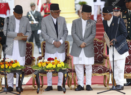 Nepalese President Ram Baran Yadav (l) Newly Elected Prime Minister Khadga Prasad Sharma Oli (r) Outgoing Prime Minister Sushil Koirala (2-l) and Parliament Speaker Subash Newang (2-r) During the Oath of Ceremony at the Presidential Office in Kathmandu Nepal 12 October 2015 Khadga Prasad Sharma Oli Became the 38th Prime Minister of Nepal Winning a Parliamentary Vote by a Majority Nepal Kathmandu