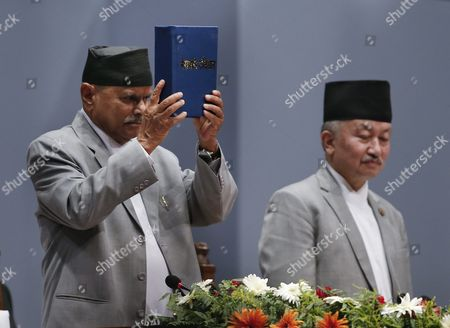 Nepalese President Ram Baran Yadav (l) Presents Nepal's New Constitution As Subash Newang (r) Head of the Constitution Assembly Looks on During a Session at the Constitution Assembly Hall in Kathmandu Nepal 20 September 2015 Several Ethnic Communities of Nepal Including Newar Madeshi and Tharu Are Protesting Against the New Constitution Saying This New Constitution Will not End Their Discrimination Nepal Kathmandu