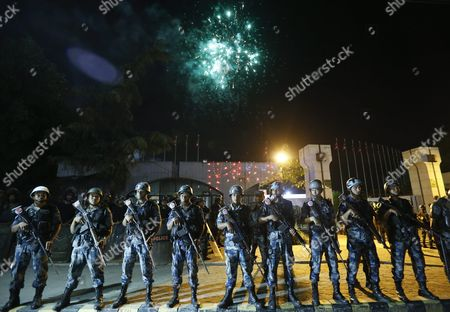 Nepalese Armed Police Stand Guard While Fireworks Are Displayed After President Ram Baran Yadav Unveiled the New Nepal Constitution at the Constitution Assembly Hall in Kathmandu Nepal 20 September 2015 Several Ethnic Communities of Nepal Including Newar Madeshi and Tharu Are Protesting Against the New Constitution Saying This New Constitution Will not End Their Discrimination Nepal Kathmandu