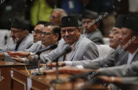 Pushpa Kamal Dahal (c) Known As Prachanda Head of Unified Maoist Party Applauds After President Ram Baran Yadav Unveils the New Nepal Constitution During a Session at the Constitution Assembly Hall in Kathmandu Nepal 20 September 2015 Several Ethnic Communities of Nepal Including Newar Madeshi and Tharu Are Protesting Against the New Constitution Saying This New Constitution Will not End Their Discrimination Nepal Kathmandu